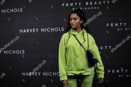 Stock Image of Cassey Chanel poses for photographers upon arrival at the Fenty Beauty by Rihanna fashion range launch during London Fashion Week in London