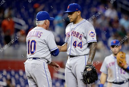 AJ Ramos, Terry Collins. New York Mets relief pitcher AJ Ramos (44) is relieved from the game by manager Terry Collins during the ninth inning of a baseball game against the Miami Marlins, in Miami. The Marlins won 5-4 in ten innings