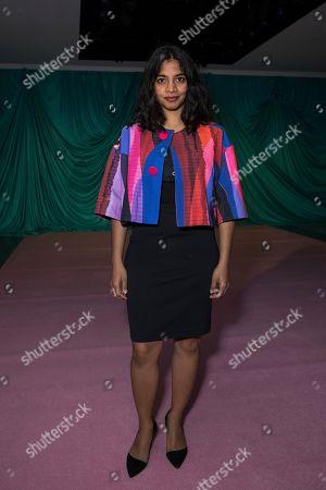 Amara Karan poses for photographers upon arrival at the Emilio de la Morena Spring/Summer 2018 runway show at London Fashion Week in London