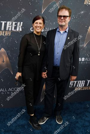 """Rainn Wilson, Holiday Reinhorn. Rainn Wilson, right, a cast member in """"Star Trek: Discovery,"""" poses with his wife Holiday Reinhorn at the premiere of the new television series, in Los Angeles"""
