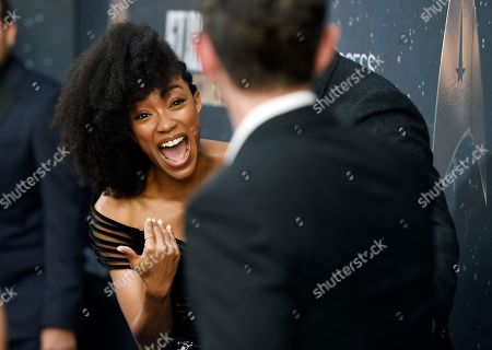 """Sonequa Martin-Green, James Frain. Sonequa Martin-Green, left, a cast member in """"Star Trek: Discovery,"""" gestures to fellow cast member James Frain at the premiere of the new television series, in Los Angeles"""