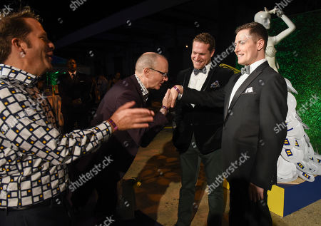 Stock Picture of Fans of YouTube Star Randy Rainbow, right, kiss his hand during the Human Rights Campaign's Chefs for Equality event at Dock5 at Union Market on in Washington