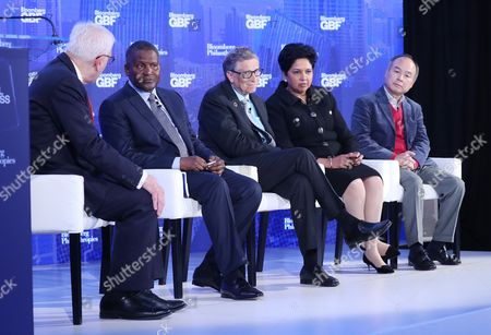 (L-R) Moderator and co-CEO of the Carlyle Group David M. Rubenstein, Chief Executive of Dangote Industries Limited Aliko Dangote, Bill and Melinda Gates Foundation co-founder Bill Gates, PepsiCo Chairman and CEO Indra Nooyi and SoftBank Group Corp. Chairman and CEO Masayoshi Son during a discussion titled 'How Technology is Disrupting Poverty, Energy and Health Care' during the inaugural Bloomberg Global Business Forum at the Plaza Hotel in New York, New York, USA, 20 September 2017. The forum will feature more than 50 heads of state and 250 international CEOs as it is held on the sidelines of the ongoing nearby General Debate of the United Nations General Assembly.