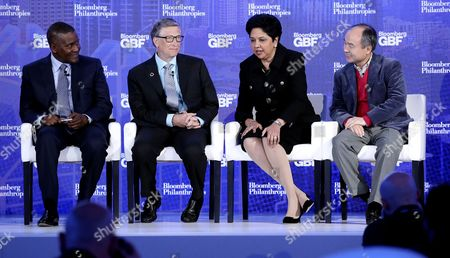 (L-R) Chief Executive of Dangote Industries Limited Aliko Dangote, Bill and Melinda Gates Foundation co-founder Bill Gates, PepsiCo Chairman and CEO Indra Nooyi and SoftBank Group Corp. Chairman and CEO Masayoshi Son during a discussion titled 'How Technology is Disrupting Poverty, Energy and Health Care' during the inaugural Bloomberg Global Business Forum at the Plaza Hotel in New York, New York, USA, 20 September 2017. The forum will feature more than 50 heads of state and 250 international CEOs as it is held on the sidelines of the ongoing nearby General Debate of the United Nations General Assembly.