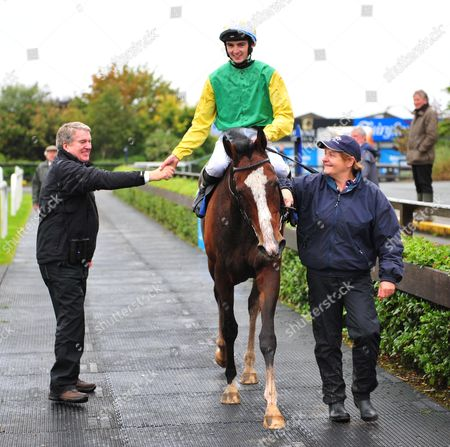 Fairyhouse Jockey Oisin Orr is congratulated by owner John Breslin after they won the Fairyhouse Handicap with TUDOR CITY.