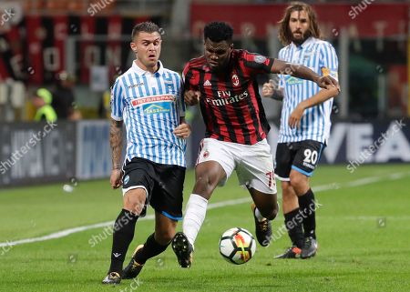 Spal's Federico Viviani, left, challenges AC Milan's Franck Kessie during a Serie A soccer match at the Milan San Siro Stadium, Italy