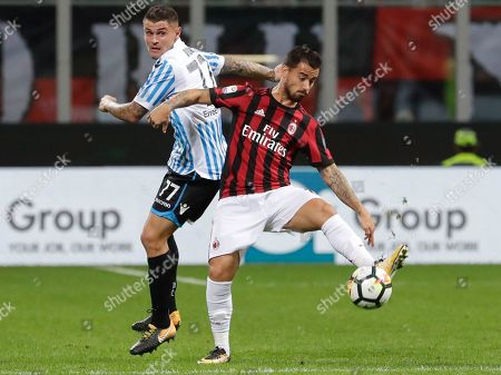 Spal's Federico Viviani, left, and AC Milan's Suso go for the ball during the Serie A soccer match between AC Milan and Spal, at the Milan San Siro Stadium, Italy