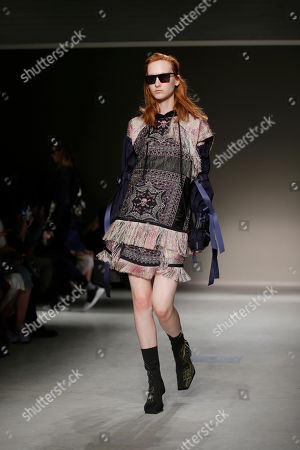 Stock Picture of A model wears a creation as part of the Angela Chen womens Fall/Winter 2018/19 fashion collection, presented in Milan, Italy
