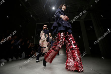 Models wear creations as part of the Angela Chen womens Fall/Winter 2018/19 fashion collection, presented in Milan, Italy