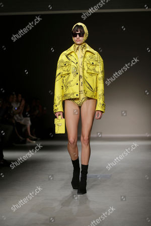 Stock Image of A model wears a creation as part of the Angela Chen womens Fall/Winter 2018/19 fashion collection, presented in Milan, Italy