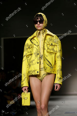 Stock Photo of A model wears a creation as part of the Angela Chen womens Fall/Winter 2018/19 fashion collection, presented in Milan, Italy