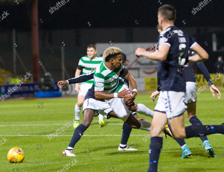 Scott Sinclair of Celtic fouled inside the penalty box by Glen Kamara of Dundee