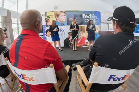 Hines Ward, Patrick Reed. Pittsburgh Steelers legend Hines Ward, left, and 2017 Presidents Cup U.S. team member Patrick Reed, right, listen to students from JA of Southwest New England present their original company concept, Lo-K8, at the FedEx Junior Business Challenge at the PGA TOUR's TOUR Championship, in Atlanta. Junior Achievement students from across the country presented original business concepts for the opportunity to generate a $75,000 donation from FedEx to their local JA chapter