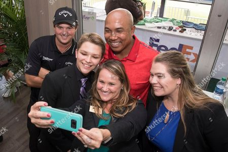 Patrick Reed, Hines Ward. Pittsburgh Steelers legend Hines Ward, center in back, and 2017 Presidents Cup U.S. team member Patrick Reed, left, take a selfie with Antibee from Junior Achievement of North Central Ohio at the PGA TOUR's TOUR Championship, in Atlanta. Ward and Reed participated as panel judges that helped select one presenting student group to receive a $75,000 donation from FedEx to their local JA chapter