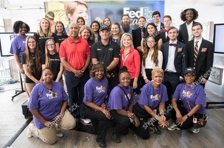 Hines Ward, Patrick Reed. Junior Achievement students celebrate after participating in the FedEx Junior Business Challenge finals at the PGA TOUR's TOUR Championship, in Atlanta. JA students from across the country presented original business concepts to a panel of judges, which included Pittsburgh Steelers legend Hines Ward, third from left on second row, and 2017 Presidents Cup U.S. team member Patrick Reed, fourth from left on second row, for the chance to generate a $75,000 donation from FedEx to their local JA chapter