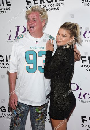 """Peter Tunney, Fergie. Peter Tunney, left, and Fergie arrives at a premiere screening of her new visual album """"Double Dutchess: Seeing Double"""" visual album at iPic Theaters Fulton Market, in New York"""