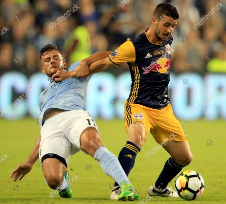 Diego Rubio, Felipe Martins. Sporting Kansas City forward Diego Rubio, left, tangles with New York Red Bulls midfielder Felipe Martins, right, during the first half in the final of the U.S. Open Cup soccer match in Kansas City, Kan