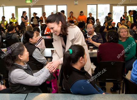 New Zealand Labour Party leader Jacinda Ardern greets staff at a mushroom factory while campaigning in Christchurch, New Zealand, . The 37-year-old is hoping to unseat conservative Prime Minister Bill English, 55, when the nation votes in the general election on Saturday, Sept. 23
