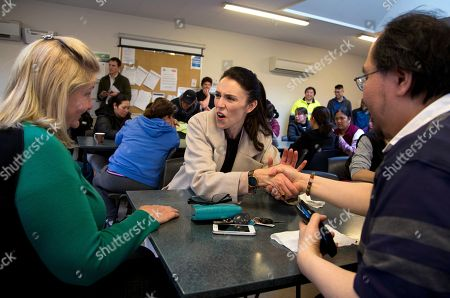 New Zealand Labour Party leader Jacinda Ardern, center, greets staff at a mushroom factory while campaigning in Christchurch, New Zealand, . The 37-year-old is hoping to unseat conservative Prime Minister Bill English, 55, when the nation votes in the general election on Saturday, Sept. 23
