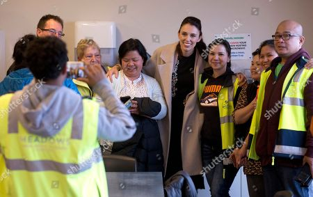 Stock Image of New Zealand Labour Party leader Jacinda Ardern, center, poses for a photo with staff at a mushroom factory while campaigning in Christchurch, New Zealand, . The 37-year-old is hoping to unseat conservative Prime Minister Bill English, 55, when the nation votes in the general election on Saturday, Sept. 23