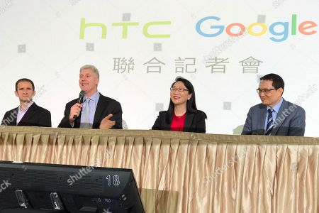 Rick Osterloh, Mario Queiroz, Cher Wang, Chai-Lin Chang. Senior vice president of hardware for Google Rick Osterloh, second from left, speaks during a press conference in New Taipei City, Taiwan, . Google is biting off a big piece of device manufacturer HTC for $1.1 billion to expand its efforts to build phones, speakers and other gadgets equipped with its arsenal of digital services. With Osterloh is, from left, Mario Queiroz, vice president of product management at Google, Cher Wang, chairperson of HTC, and Chia-Lin Chang, president of smartphones and connected devices for HTC