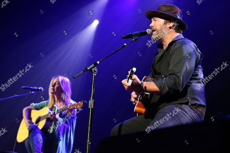 """Jessi Alexander, Lee Brice. From left, songwriter Jessi Alexander and artist Lee Brice perform """"I Drive Your Truck"""" at the Nashville Songwriters Association International """"50 Years of Songs"""" at the Ryman Auditorium on in Nashville, Tenn"""
