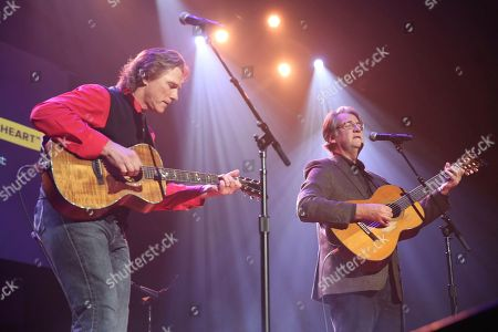 "BIlly Dean, Richard Leigh. From left, artists and songwriters Billy Dean and Richard Leigh perform ""Somewhere In My Broken Heart"" at the Nashville Songwriters Association International ""50 Years of Songs"" at the Ryman Auditorium on in Nashville, Tenn"