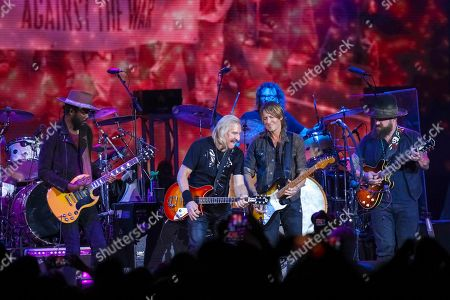 Gary Clark Jr., Joe Walsh, Keith Urban, Zac Brown. Gary Clark Jr., from left, Joe Walsh, Keith Urban and Zac Brown perform on stage during the Joe Walsh and Friends VetsAid Concert held at the Eagle Bank Arena, in Fairfax, Va