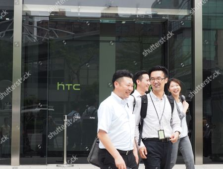 HTC employees leave HTC Corp headquarters in Hsintien, New Taipei City, Taiwan, 21 September 2017. During the HTC Google, Joint News Conference the companies announced that they have signed an agreement under which, Google will pay HTC 1.1 billion US dollars for receiving two thousand HTC smartphone research and design engineers - half of HTC's designing team - and will secure a non-exclusive license for HTC intellectual property. Cher Wang said HTC will use more advanced technology to develop flagship smartphones and virtual reality device VIVE. Rick Osterloh said HTC has been a Google partner for a long time. He welcomes HTC membes to join Google to fuel innovation and product development in consumer hardware.