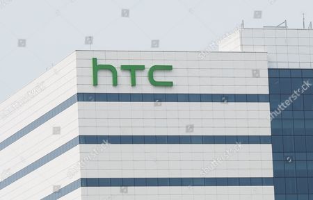 Stock Image of HTC logo at HTC Inc headquarters in Hsintien, New Taipei City, Taiwan, on 21 September 2017. On 21 September, HTC and Google held a joint news conference at HTC headquarters to announce that they have signed a cooperation agreement under which, Google will pay HTC 1.1 billion US dollars for receiving two thousand HTC smartphone research and design engineers - half of HTC's designing team - and will secure a non-exclusive license for HTC intellectual property. Cher Wang said HTC will use more advanced technology to develop flagship smartphones and virtual reality device VIVE. Rick Osterloh said HTC has been a Google partner for a long time. He welcomes HTC membes to join Google to fuel innovation and product development in consumer hardware.