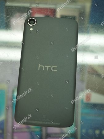 Stock Photo of An HTC smartphone at a cellphone store in Taipei, Taiwan, 21 September 2017. On 21 September, HTC and Google held a joint news conference at HTC headquarters to announce that they have signed a cooperation agreement under which, Google will pay HTC 1.1 billion US dollars for receiving two thousand HTC smartphone research and design engineers - half of HTC's designing team - and will secure a non-exclusive license for HTC intellectual property. Cher Wang said HTC will use more advanced technology to develop flagship smartphones and virtual reality device VIVE. Rick Osterloh said HTC has been a Google partner for a long time. He welcomes HTC membes to join Google to fuel innovation and product development in consumer hardware.