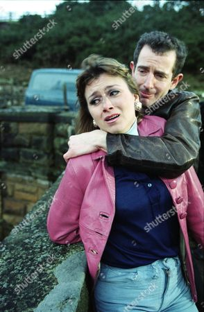 Stock Picture of Tricia Penrose (as Gina Ward) and Carl Cieka (as Brian Tranter)
