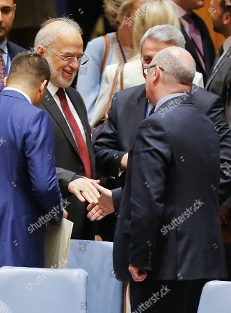Iraqi Foreign Minister Ibrahim al-Jaafari, left, and U.K. Minister of State for the Middle East Alistair Burt, right, meet with a handshake after a United Nations Security Council, at U.N. headquarters