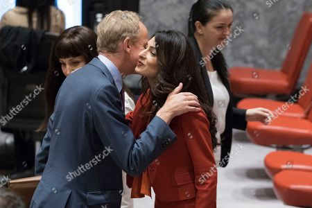 Amal Clooney, Matthew Rycroft. Human rights lawyer Amal Clooney, right, greets British Ambassador to the United Nations Matthew Rycroft before a Security Council meeting, at U.N. headquarters