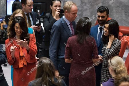 Nadia Murad, Matthew Rycroft, Nikki Haley, Amal Clooney. Human rights lawyer Amal Clooney, left, talks to a diplomat as U.S. Ambassador to the United Nations Nikki Haley, second from right, and British Ambassador Matthew Rycroft, center, speak to Clooney's client Nadia Murad, right, before a Security Council meeting, at U.N. headquarters