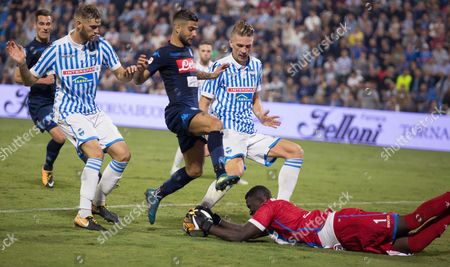 SPAL's keeper Alfred Gomis saves from Napoli's Lorenzo Insigne.