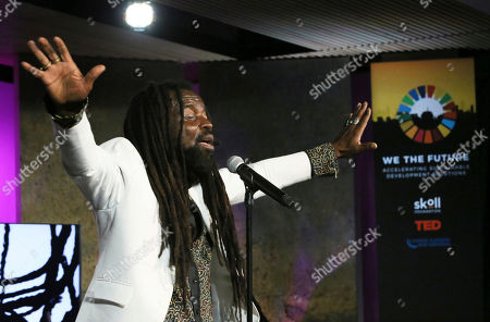 Stock Image of GRAMMY-nominated musician and Ambassador for the Global Alliance for Clean Cookstoves, Rocky Dawuni, performs at 'We The Future' at Ted Theater on in New York. 'We The Future', a partnership between the Skoll Foundation, the UN Foundation and TED, showcased bold models of change that have been applied on a local and global scale to create a world a sustainable peace and prosperity