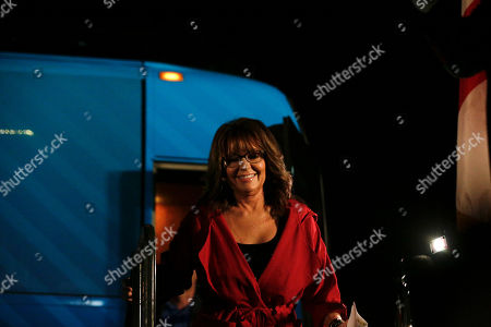 Former Alaska Gov. Sarah Palin walks off the bus before she speaks at a rally, in Montgomery, Ala. Palin is in Montgomery to support support of Judge Roy Moore for the U.S. Senate candidacy