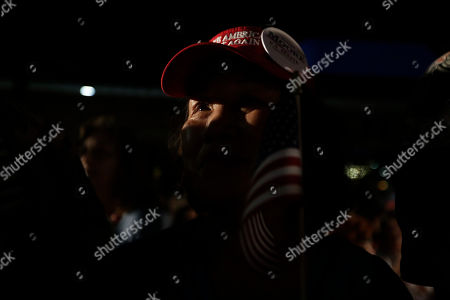 Chu Green, of Mobile, Ala., waits for former Alaska Gov. Sarah Palin to speak at a rally, in Montgomery, Ala. Palin is in Montgomery to support support of Judge Roy Moore for the U.S. Senate candidacy