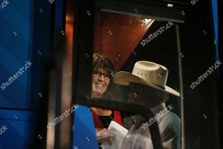 Former vice presidential candidate Sarah Palin gets off the bus before a rally, in Montgomery, Ala. Palin is in Montgomery to support Judge Roy Moore for the U.S. Senate candidacy