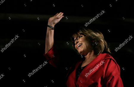 Former Alaska Gov. Sarah Palin waves to the crowd before speaking at a rally, in Montgomery, Ala. Palin is in Montgomery to support Judge Roy Moore's candidacy for the U.S. Senate