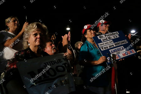 Supporters of former Alaska Gov. Sarah Palin and U.S. Senate candidate Judge Roy Moore attend a rally, in Montgomery, Ala. Palin is in Montgomery to support Judge Roy Moore's candidacy for the U.S. Senate