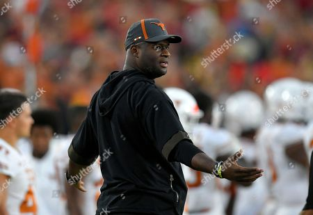 Former Texas quarterback Vince Young stands on the sidelines during the first half of an NCAA college football game between Southern California and Texas, in Los Angeles