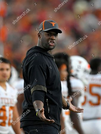 Stock Photo of Former Texas quarterback Vince Young stands on the sidelines during the first half of an NCAA college football game between Southern California and Texas, in Los Angeles