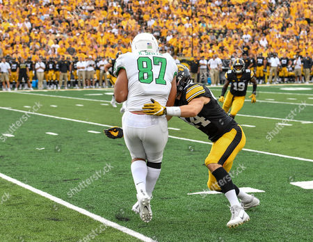 North Texas Mean Green tight end Kelvin Smith (87) catches a pass as he is immediately hit hard by Iowa Hawkeyes linebacker Ben Niemann (44) during an NCAA Football game between the Iowa Hawkeyes and the North Texas Mean-Green Eagles at Kinnick Stadium in Cedar Rapids, Iowa
