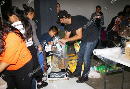Jose Maria Yazpik helps at collection centre