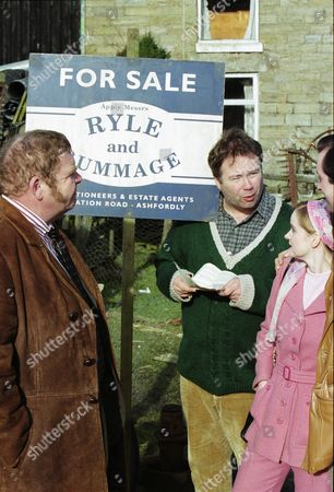 Stock Photo of Geoffrey Hughes (as Vernon Scripps), David Lonsdale (as David Stockwell), Pauline Moriarty (as Mrs. Rogers) and Stephen Hawksby (as Mr. Rogers)