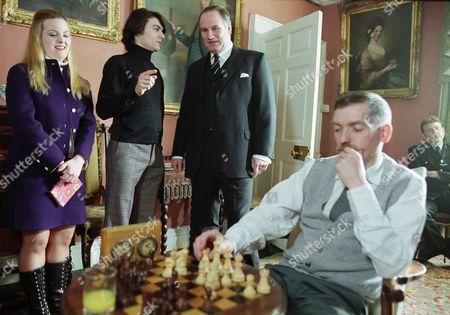 Jo Joyner (as Anna Young), Jalaal Hartley (as Leonid Vorodin), Rupert Vansittart (as Lord Ashfordly) and Mark Jordon (as PC Phil Bellamy) far right
