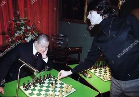 Derek Fowlds (as Oscar Blaketon) and Jalaal Hartley (as Leonid Vorodin)