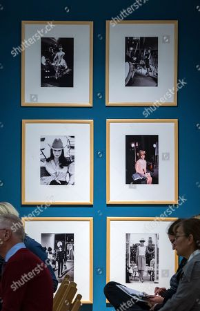 Visitors stands in front of photographs displaying Audrey Hepburn by Bob Willoughby during the press preview of the exhibition 'Stars of the screen - Audrey Hepburn, Liz Taylor, Grace Kelly, Marlene Dietrich - photographs taken by Milton H. Greene und Bob Willoughby' in Apolda, central Germany, . The exhibition shows more than 150 black-and-white and color photographs of the Hollywood stars. The exposition starts on Sept. 24, 2017 and lasts until Dec. 17, 2017